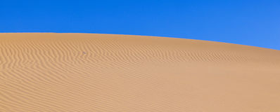 Wavy Pattern in Desert Sand Stock Photography