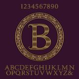 Wavy patterned gold letters and numbers with initial monogram. Elegant font and elements kit for logo design Stock Photos