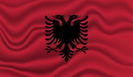 Flag of Albania. Wavy and realistic Flag of Albania isolated in white. realistic fabric effect Royalty Free Stock Image
