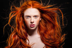 Wavy Red Hair. Golden Fashion Girl Portrait.Wavy Red Hair. Black Background stock images