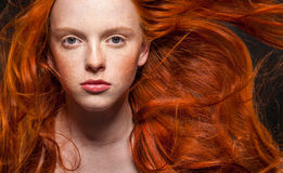 Wavy Red Hair. Golden Fashion woman Portrait.Wavy Red Hair. Black Background royalty free stock photography