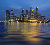 Wavy Reflection of Singapore. Singapore central business district at evening Stock Images