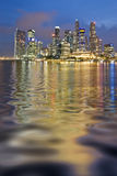 Wavy Reflection Of Singapore. Singapore central business district at Evening Stock Image