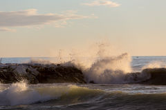 Wavy sea and cliff in Marina di Massa Royalty Free Stock Image