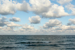 Wavy sea and clouds Stock Images