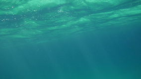 Wavy Sea Surface Underwater. Slow motion underwater shot of a wavy sea surface stock video footage