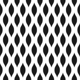 Wavy seamless pattern background in black and white. Vintage and retro abstract ornamental design of spiky ovals or lens Royalty Free Stock Photos