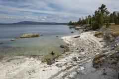 Wavy shoreline of Yellowstone Lake, with white limy beach, Wyomi Royalty Free Stock Images