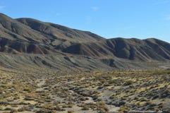 Wavy Southern California Mountain Range in Desert. Wavy California Desert Floor and Mountain Range Royalty Free Stock Image