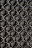 Wavy steel decoration on a wall Stock Photography
