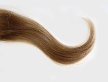 Wavy strand of blonde hair. A wavy strand of blonde hair stock photo