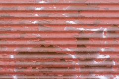 Wavy texture of corrugated iron rusty red color Stock Photography