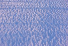 Wavy textured snow wind effect, natural background, close up detail. Top view stock images