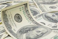 Wavy US dollar bill. Close up of wavy US one hundred dollar bill Stock Photo