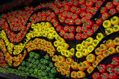 A wavy wall of colourful peppers. A wavy wall of green ,red, yellow ,orange and green peppers Stock Images
