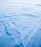 Wavy wind patterns in snow Royalty Free Stock Images
