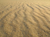 Wavy yellow sand texture background Stock Images