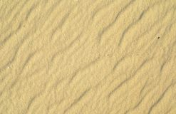 Wavy yellow sand texture background Royalty Free Stock Photos