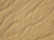 Wavy yellow sand texture background Royalty Free Stock Photography