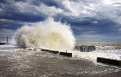 Wawe splashes sea storm. Beach, beautiful, beauty, blue, boat, clouds, color, crashing, fall, foam, haven, horizon, landscape, lighthouse, liquid, natural Royalty Free Stock Photos