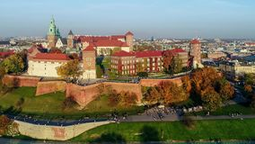 Wawel Castle, Catherdral and Vistula River, Krakow, Poland in fall at sunset. Aerial video. stock footage