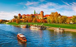Wawel castle famous landmark in Krakow Poland. Picturesque landscape on coast river Wisla. Autumn sunset with white sky and cloud stock photo