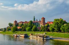 Wawel castle famous landmark in Krakow Poland. River Wisla view. Summer or spring green landscape royalty free stock image