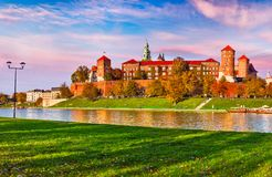 Wawel castle famous landmark in Krakow Poland. Picturesque landscape on coast river Wisla. Autumn sunset with pink sky and white cloud royalty free stock photo
