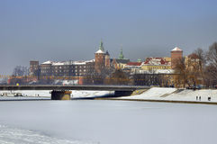 Wawel Castle and frozen Vistula river in Krakow. Historic royal Wawel Castle in winter and frozen Vistula river with Podwawelski Bridge in Cracow, Poland stock photo
