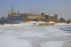 Wawel Castle in Krakow and frozen Vistula river. Historic royal Wawel Castle in Cracow, Poland, with frozen Vistula river in winter royalty free stock photo