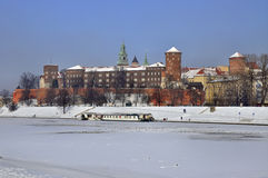 Wawel Castle in Krakow and frozen Vistula river. Winter view of historic royal Wawel Castle in Cracow, Poland, with frozen Vistula river and harbor Royalty Free Stock Photo