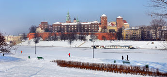 Wawel Castle in Krakow and frozen Vistula river. Winter panorama of historic royal Wawel Castle in Cracow, Poland, with frozen Vistula river royalty free stock photography