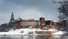 Wawel Castle in Krakow and Vistula river in winter. Historic royal Wawel Castle in Cracow, Poland, with Vistula river on a cloudy day in winter stock photography