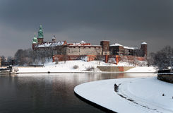 Wawel Castle in Krakow and Vistula river in winter. Historic royal Wawel Castle in Cracow, Poland, with Vistula river in sunset light on a cloudy day in winter royalty free stock photography