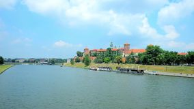 Castle by the river, Krakow, Poland. The Wawel Castle is towering among lush greenery on the bank of Vistula river, Krakow, Poland stock video