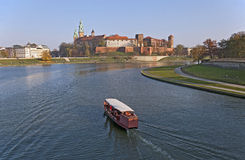 Wawel Castle and Vistula River. Wawel Castle, Vistula river and tourist boat in Cracow, Poland, at sunset royalty free stock photo