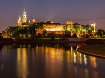 Wawel castle and Vistula river at night Stock Photos