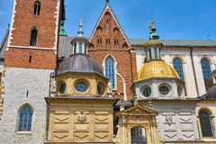 Wawel Cathedral in Krakow Poland the domes above the entrance royalty free stock photo
