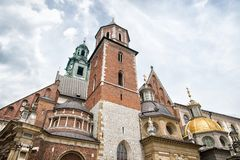 Wawel cathedral with tower and chapels in krakow, poland. Catholic church of gothic style on cloudy sky. Architecture and design. Royalty Free Stock Image