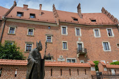 Wawel complex in Krakow. A view of the gardens of the Wawel complex in Krakow featuring the statue of Pope John Paul II royalty free stock images