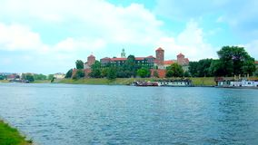 Wawel Fortress on the bank of Vistula river, Krakow, Poland. The joyful walk along the bank of Vistula river with a view on picturesque Wawel Fortress stock video
