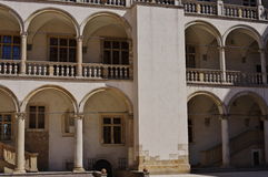 Wawel. Krakow, Poland, July 28, 2015. Wawel Royal Castle, seat of Polish kings from the 12th to 17th century. Courtyard with arcades Royalty Free Stock Photos