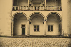 The Wawel Royal Castle in Cracow, Poland. Old style photo of renaissance arcades. The Wawel Royal Castle in Cracow, Poland Stock Photography