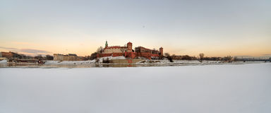 Wawel Royal Castle in Cracow. Poland, the Wawel Royal Castle in Cracow, on the frozen river Wisła Stock Images