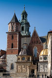 Wawel Royal Castle in Krakow. The towers of the Wawel Royal Castle in Krakow  in  Old Town Krakow, Poland. Green oxidised copper domes set against blue sky Stock Photos