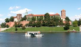 Wawel Royal Castle and travel ship on the river vistula Royalty Free Stock Photography
