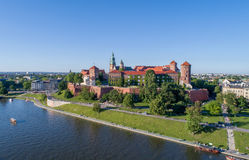 Wawel Zamek Castle in Krakow, Poland. Historic royal Wawel castle in Cracow, Poland with park and Vistula river. Aerial view at sunset Stock Image