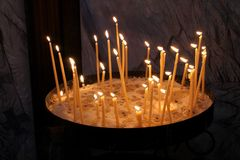 Thirty burning wax candles in cathedral,Melbourne Stock Image