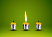 Wax candle into lighting bulb Royalty Free Stock Photo