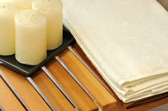 Wax candle and towel for SPA. Putting at wooden closet, shown as SPA or washroom internal and setting Royalty Free Stock Photography